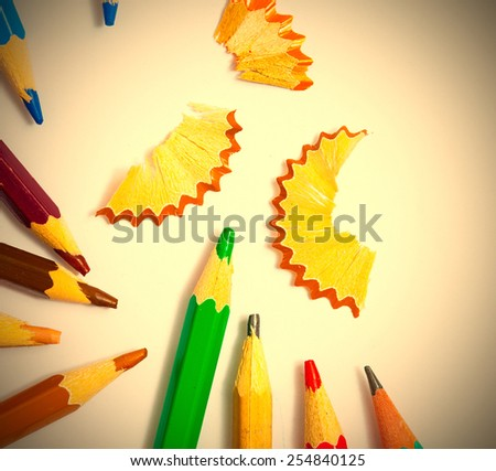 set of vintage colored pencils with chips on white background. instagram image retro style - stock photo