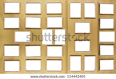 Set of vintage golden picture frames, isolated over wooden stand board - stock photo