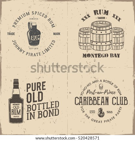 Set of vintage handcrafted pirates emblems, labels, logos. Isolated on a scratched paper background. Sketching filled style. Pirate and sea symbols - old rum bottles, barrels, skull.