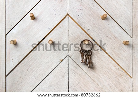 set of  vintage keys on wooden wall - stock photo
