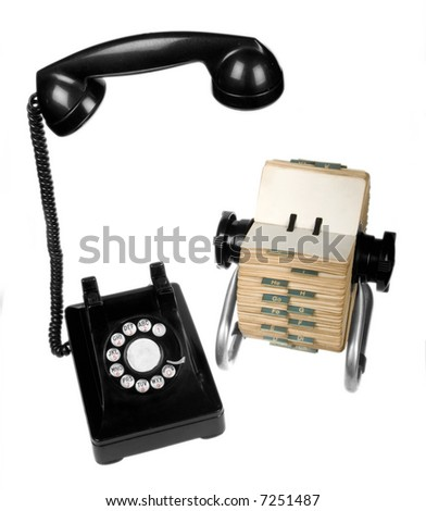 Set of vintage retro rotary telephone and rotary card file on white background - stock photo
