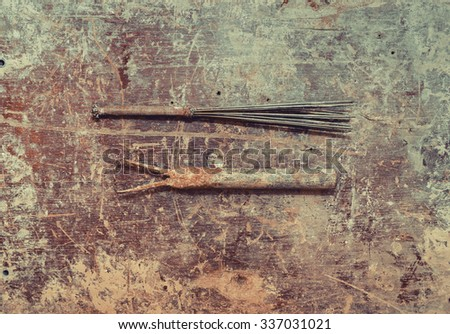 Set of vintage sculpture tools on wooden background. Top view. Vintage effect.