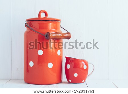 Set of vintage utensils, milk can and small polka dots milkman, home kitchen decor in country style, painted white background - stock photo