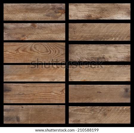 Set of vintage weathered wooden planks isolated on black background - stock photo