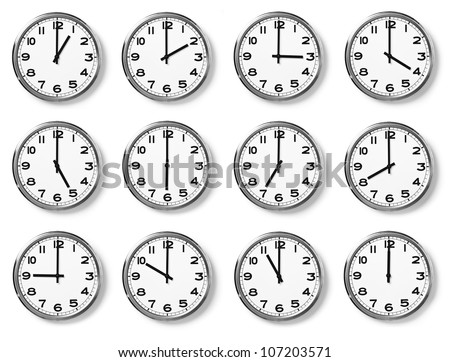 set of wall clocks with another times - stock photo