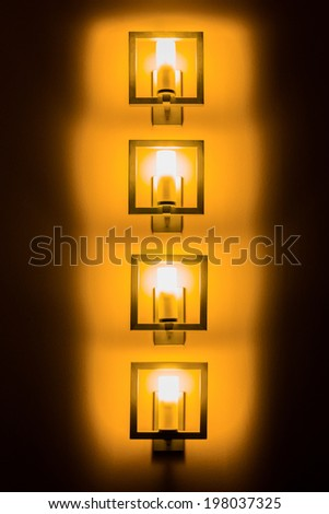 Set of wall lamps in the darkness - stock photo
