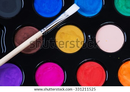 Set of watercolor paints and brushes