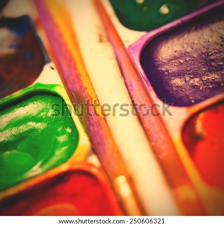 set of watercolor paints, shallow depth of field. instagram image retro style - stock photo