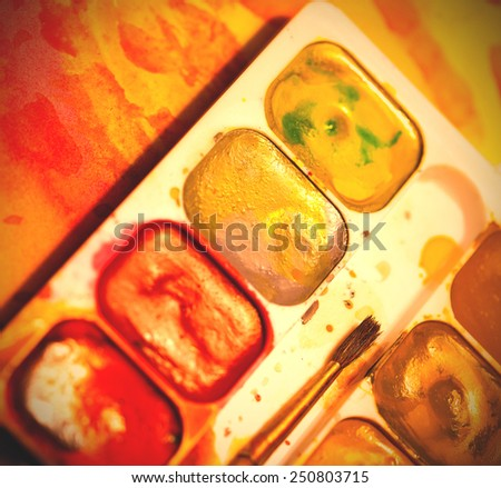 set of watercolor paints with brush, shallow depth of field. instagram image retro style - stock photo