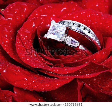 a stock rings wedding with red on rose photo background white colourbox image
