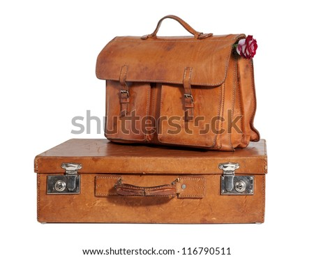 Set of Well-Traveled Vintage Suitcase and Briefcase isolated on white - stock photo