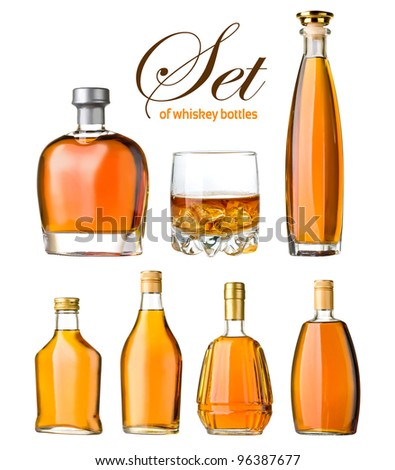 set of whiskey bottles and glass isolated - stock photo