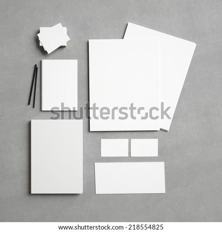 Set of white branding elements on fabric background - stock photo
