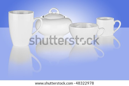Set of White Cups and Sugar Bowl on Blue Background - stock photo