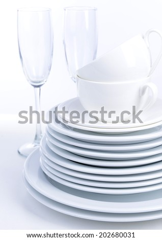 Set of white dishes isolated on white - stock photo