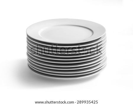 Set of white dishes on table on light background with clipping path - stock photo