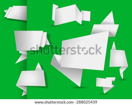 set of white origami tags, banners and labels on a green background - stock photo