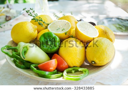 Set of whole and sliced red, green vegetables and yellow fruits
