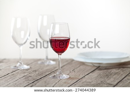 set of wine glasses on wooden table - stock photo