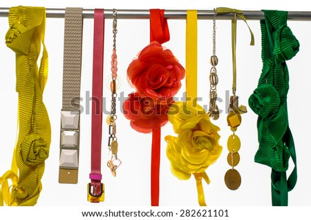 Set of woman belts and flower made of silk and satin dangle - stock photo