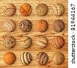 Set of wooden balls against veneer - stock vector