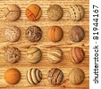 Set of wooden balls against veneer - stock photo