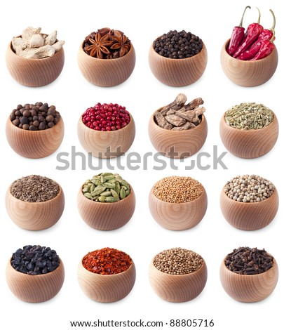 set of wooden bowls full of different spices isolated on white background - stock photo