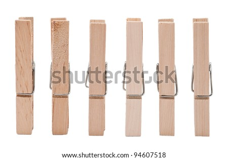 Set of wooden clothes pins on white background - stock photo