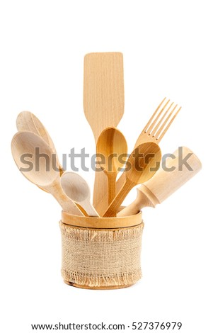 Set of wooden kitchen utensils isolated on white background.