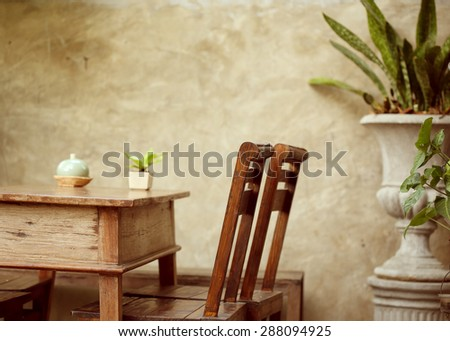 set of wooden table and chair decorated in garden, interior of cafe coffee shop with natural - stock photo
