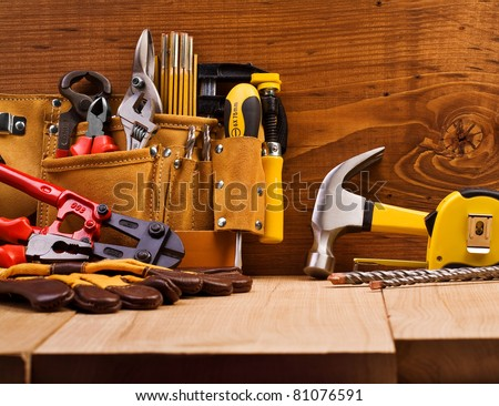 set of working tools on board background - stock photo