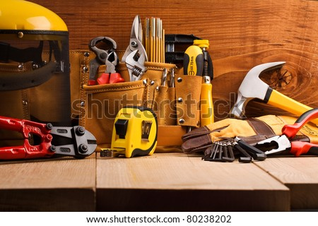 set of working tools on wooden boards - stock photo