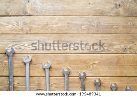 Set of wrenches on the wooden background