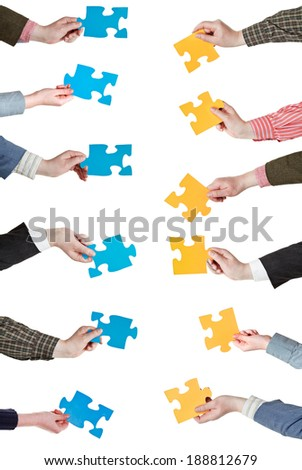 set of yellow and blue puzzle pieces in opposite sides in people hands isolated on white background