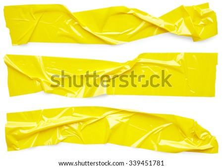 Set of yellow scotch tape isolated on white background - stock photo