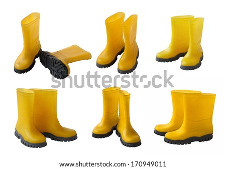Set 6 pair of yellow gumboots isolated on white background - stock photo
