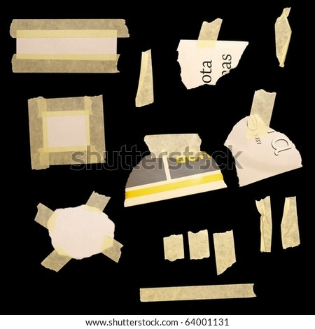 set paper scraps, newspaper and masking tape isolated on black background