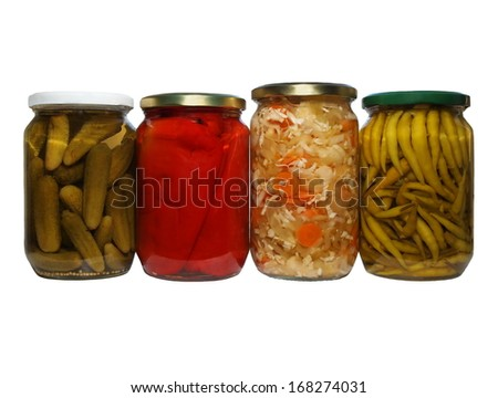 set pickles, cayenne pepper, mixed salad, chillies, winter stores, isolated on white background - stock photo
