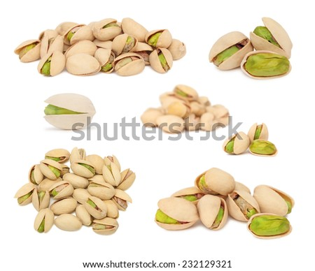 Set ripe pistachio nuts isolated on white background - stock photo