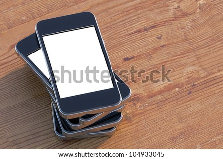 set smartphones with touch screen technology on a wooden surface (left composition version) - stock photo