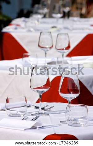 Set tables at a restaurant - stock photo