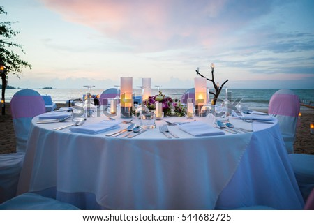 Set the table for dinner on the beach.(Selective Focus)