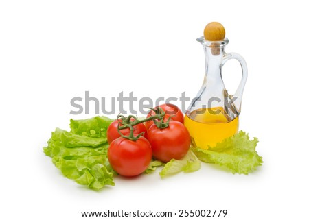 Set vegetable and jug of vegetable oil isolated on the white background  - stock photo