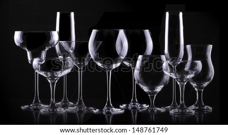 set with different empty glasses on black background - beer,champagne,cola,cocktail,wine,brandy,whiskey,scotch,vodka,cognac