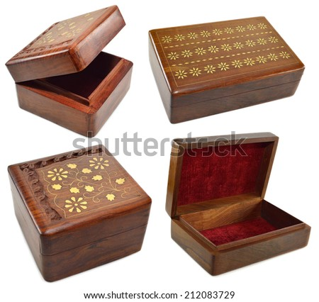 Set with wooden boxes with incrustation isolated on white - stock photo