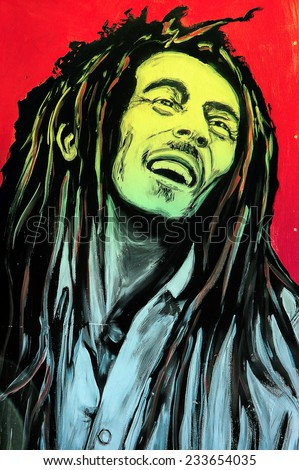 SETE, FRANCE  - SEPTEMBER 21, 2014: Graffiti portrait of Bob Marley, a famous Jamaican reggae singer-songwriter and guitarist on the wall of Sete, south of France. - stock photo