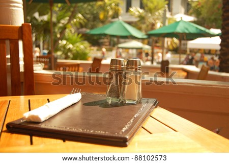 setting for meal at outdoor cafe table - stock photo