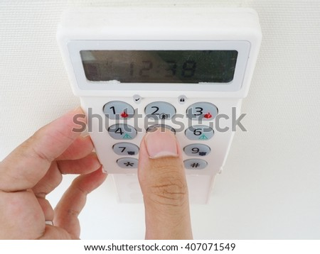 Setting home or office security alarm - stock photo