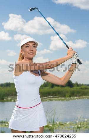 Setting new records. Vertical portrait of a beautiful happy woman in her follow through position