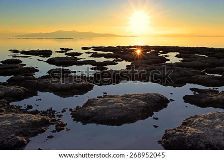 Setting sun above the Great Salt Lake, Utah, USA. - stock photo